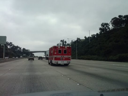 Passed by red ambulance on freeway 2/05/13 at 1:45 pm.